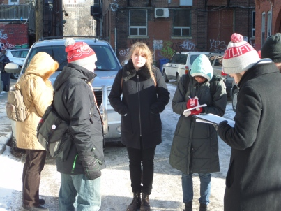 Jason from Tour Guys gives the U of T Anthropology students an introduction to Kensington Market on a cold January Day